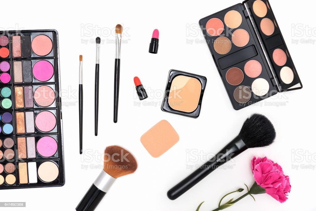 Makeup cosmetics palette and brushes on pink background stock photo