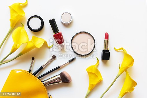 istock Makeup cosmetics tools and beauty cosmetics gift, products and facial cosmetics package lipstick with yellow lily flower on the white background, top view and copy space 1175716145