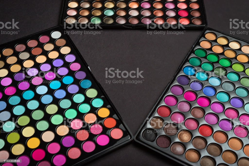 Make-up eyeshadow palettes as a colorful make-up background