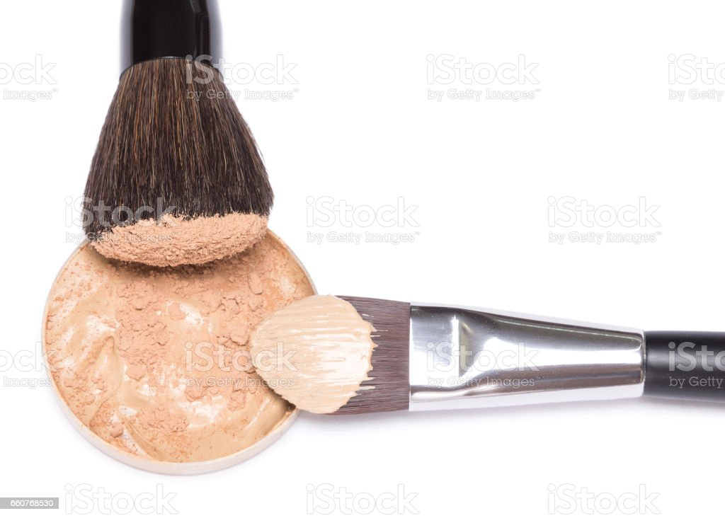 Makeup foundation and powder with brushes stock photo