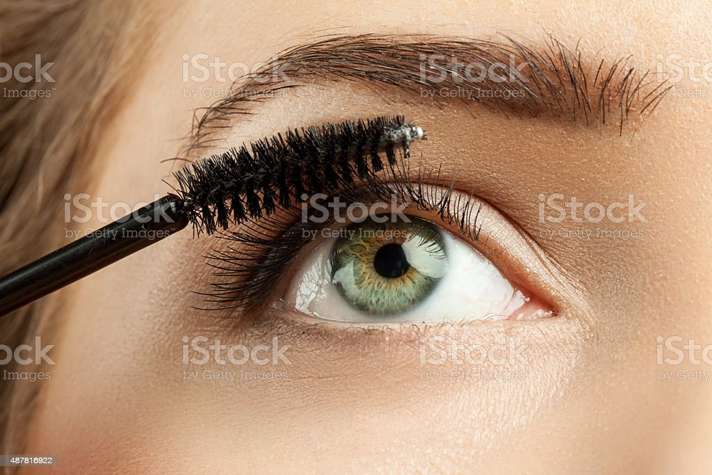 Make-up green eye with long lashes with black mascara stock photo