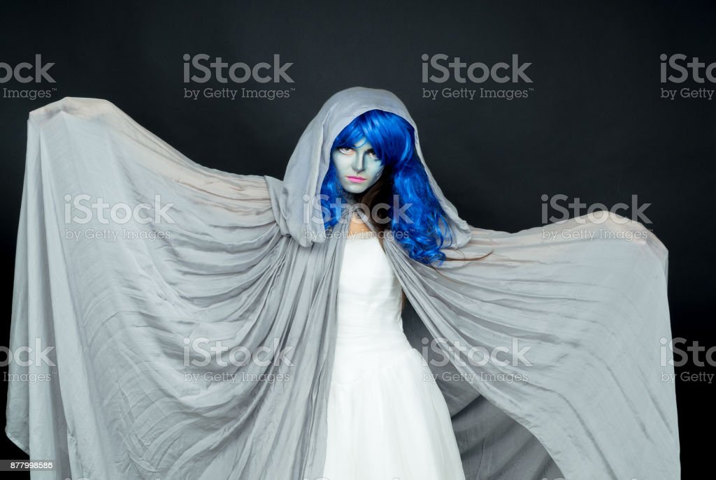Makeup. Image of a witch in a bride dress stock photo
