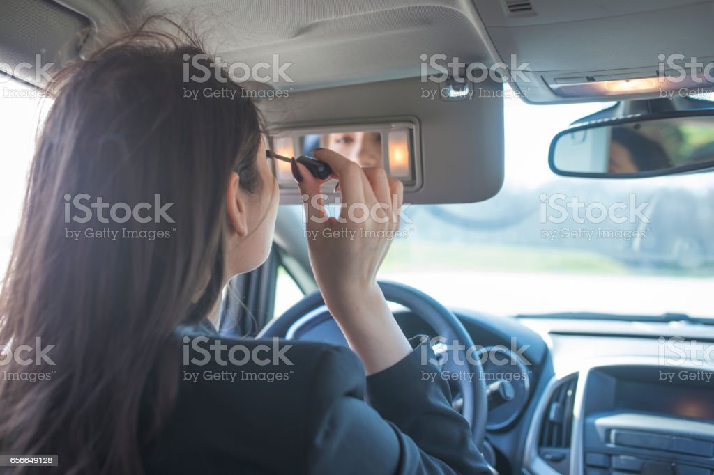 Makeup in a car stock photo