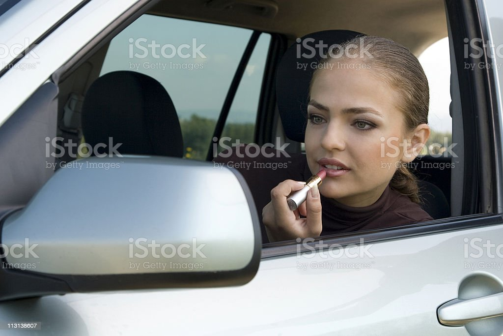 Make-up in the car royalty-free stock photo