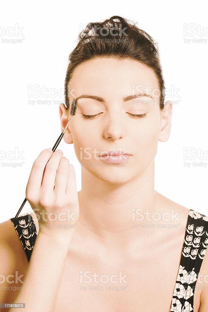 make-up instrusction - combing eyebrows royalty-free stock photo