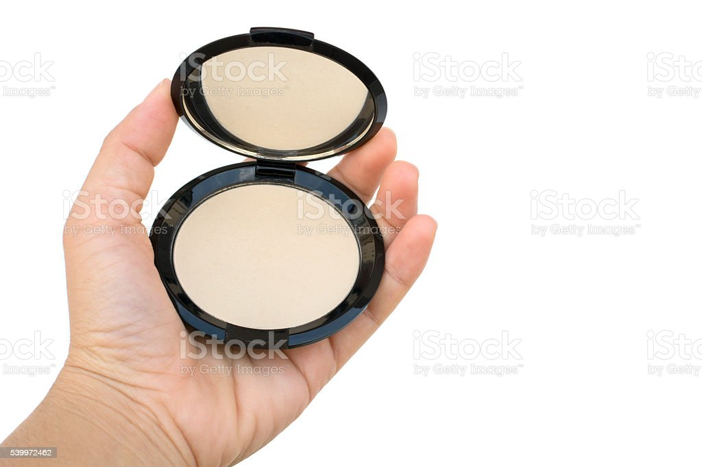 makeup pressed powder in women's hand stock photo