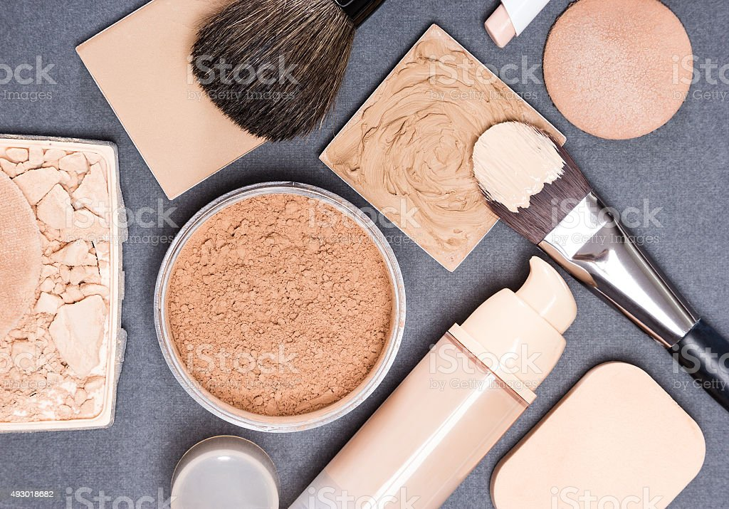 Makeup products and accessories to even out skin tone stock photo