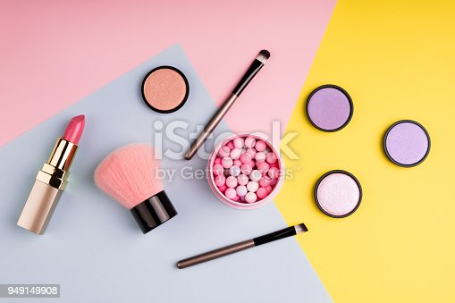 istock Makeup products and decorative cosmetics on color background flat lay. Fashion and beauty blogging concept. Top view 949149908