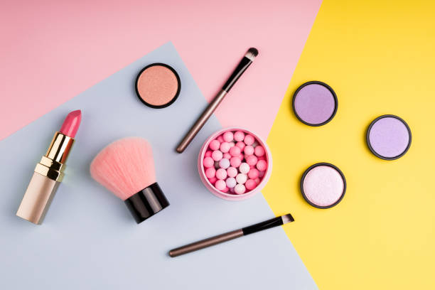 Makeup products and decorative cosmetics on color background flat lay. Fashion and beauty blogging concept. Top view stock photo