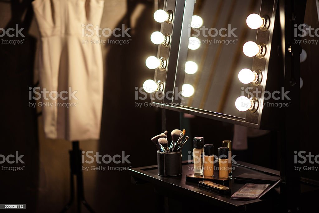 Make-up products and dress backstage stock photo