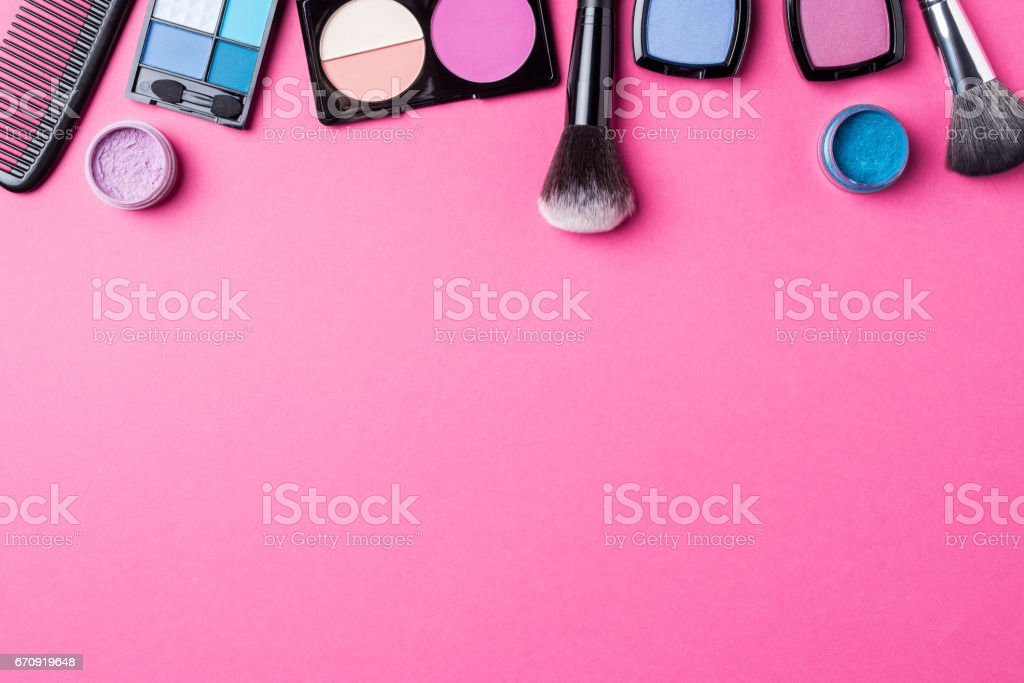 Makeup products on pink background. stock photo