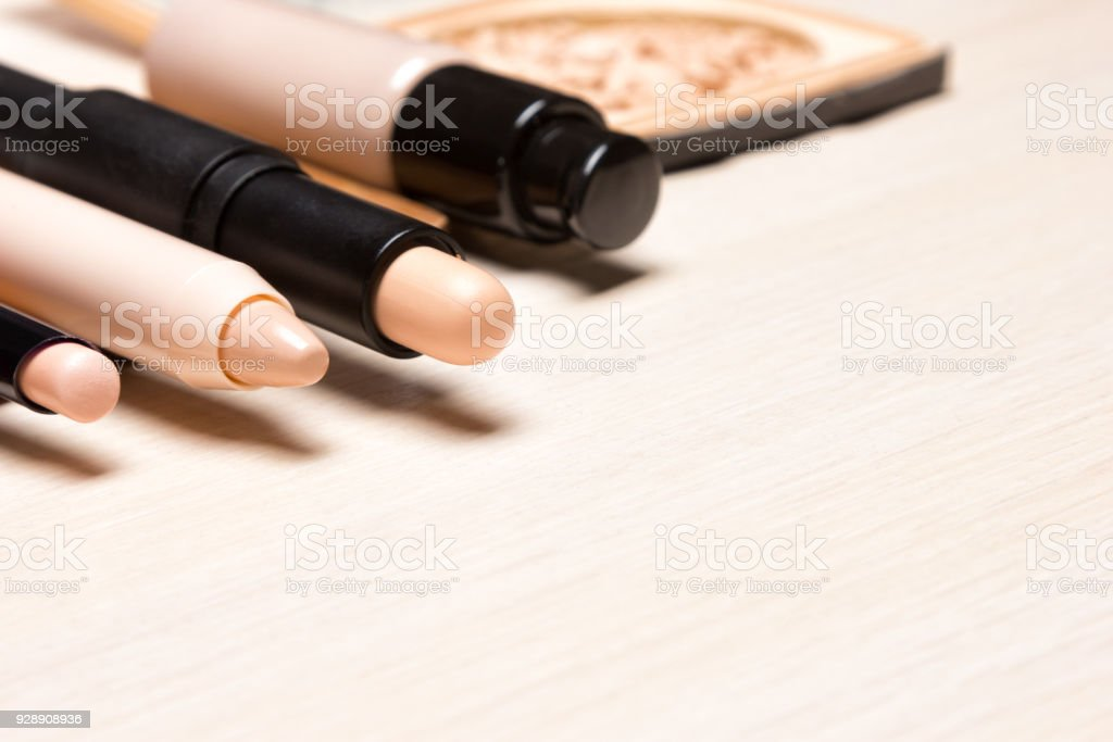 Make-up products to hide skin imperfections with copy space stock photo