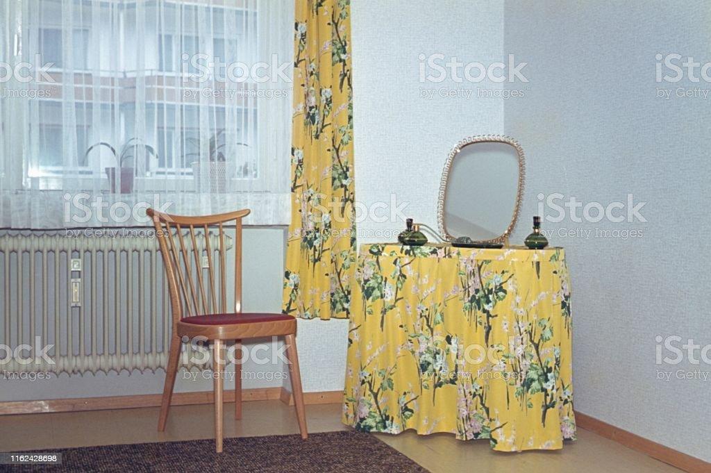 Berlin , Germany, 1966. Make-up table in the bedroom corner.