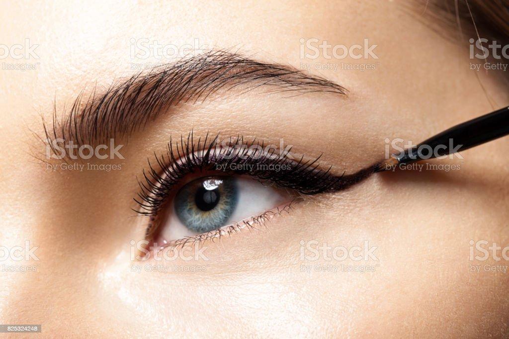 Make-up with black eyeliner close-up stock photo