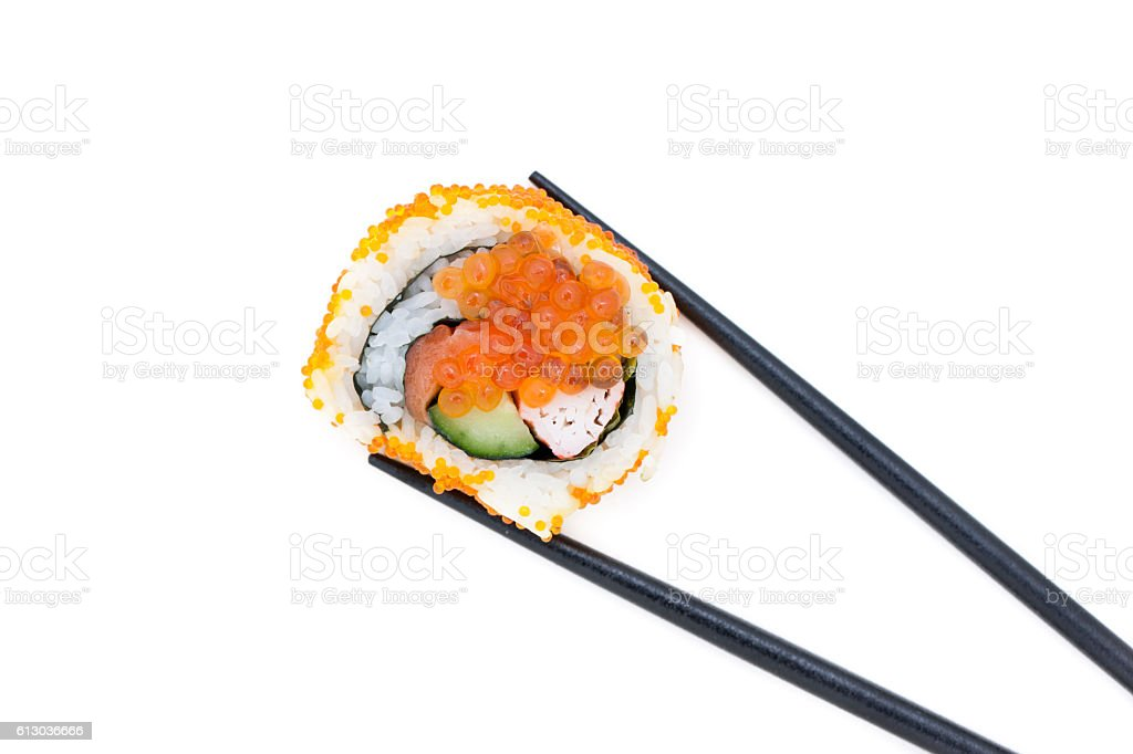 Maki sushi with chopsticks stock photo