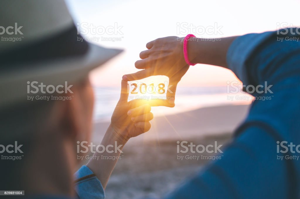 Making 2018 frame capture on the beach stock photo