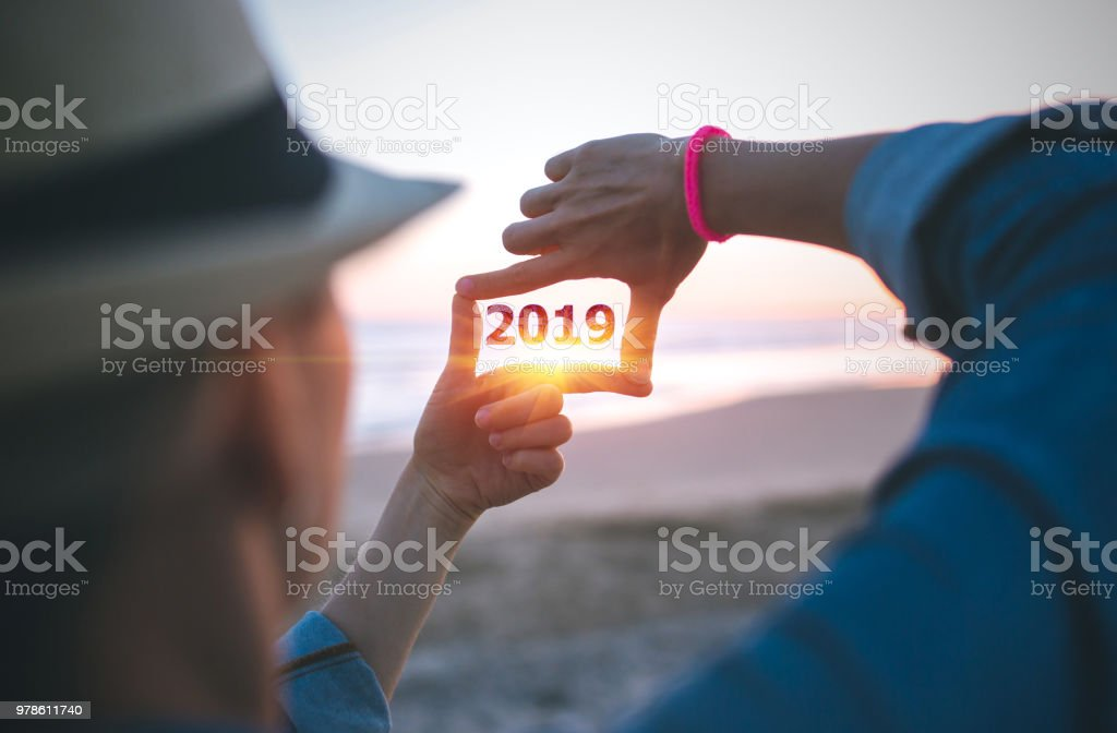 Making 2019 frame capture on the beach stock photo