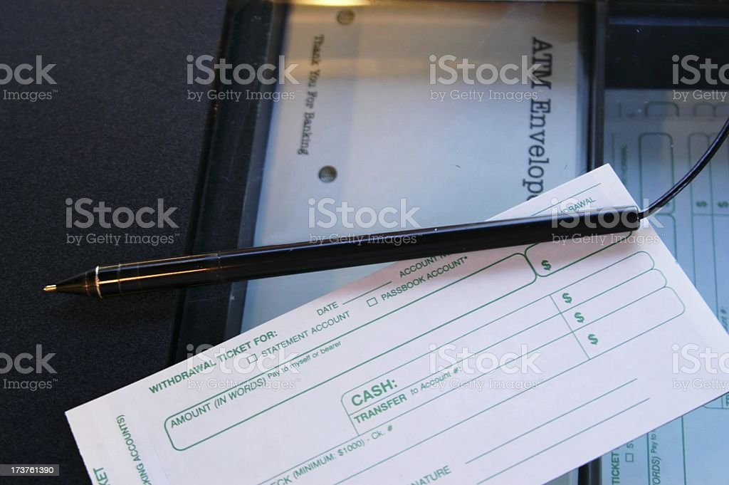Making a Bank Withdrawal royalty-free stock photo