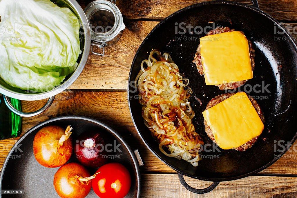 Making a burger on pan stock photo