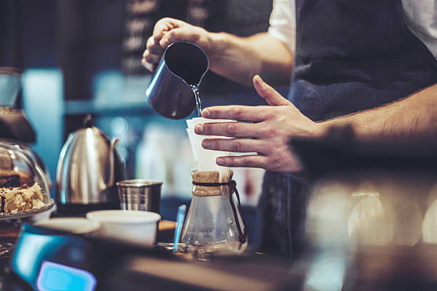 making a coffee - barista stock photos and pictures
