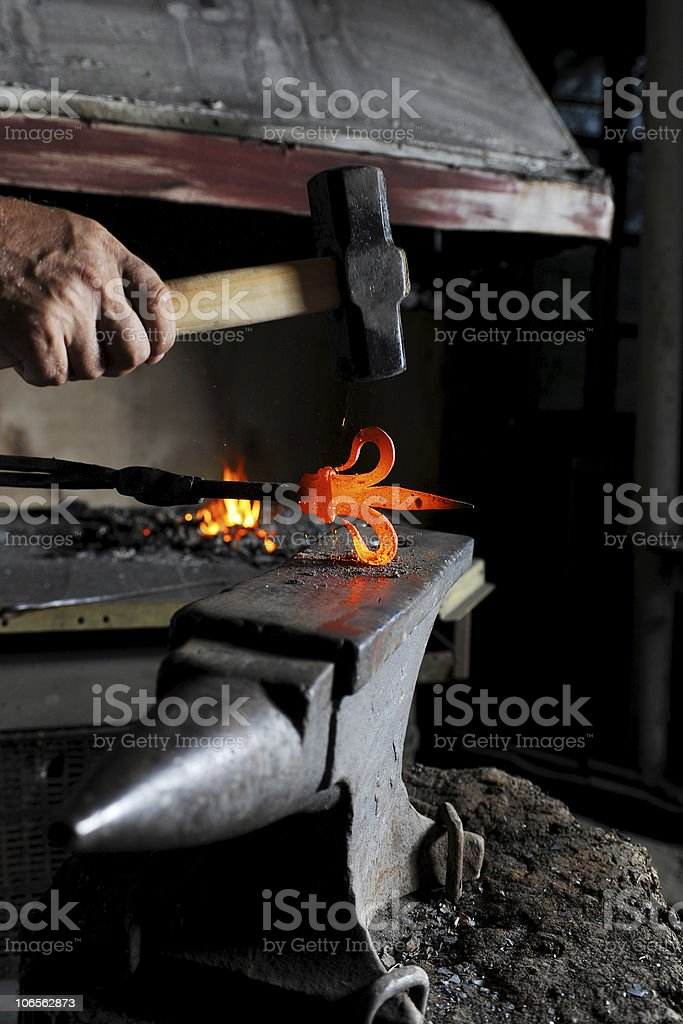 Making a decorative pattern on the anvil royalty-free stock photo
