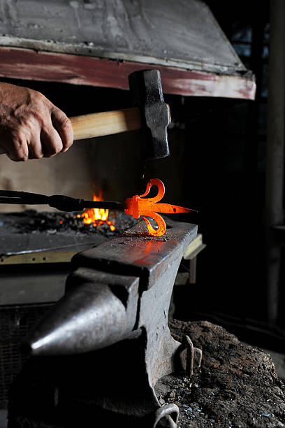 Making a decorative pattern on the anvil stock photo