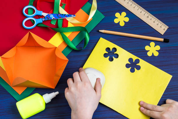 Making a gift box by the child. Step 5 stock photo