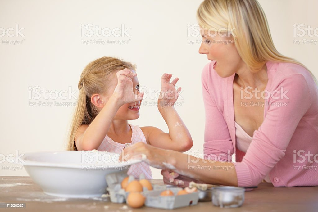 Making a marvelous mess with mum royalty-free stock photo