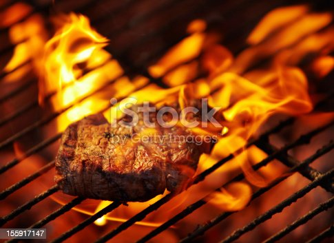 Closeup of a tasty steak cooking on a fire
