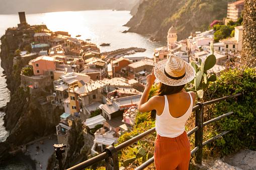 Female tourist making a photo of Vernazza , Cinque Terre
