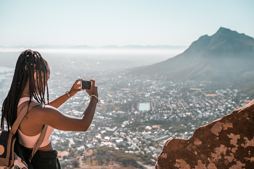 Young woman making the photo of Cape Town, South Africa.