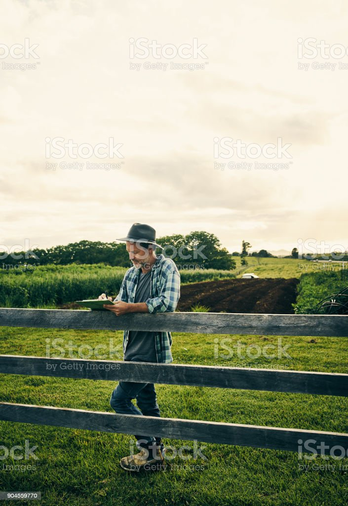 Making a note of everything that happens on the farm stock photo