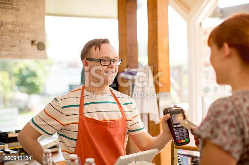 istock Making a Payment in the Farm Cafe 860943134