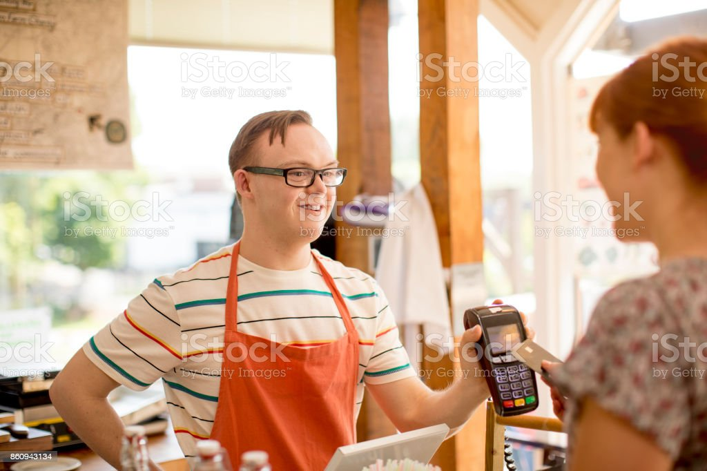 Making a Payment in the Farm Cafe - foto stock