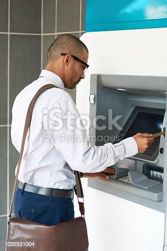 istock Making a quick stop for some cash 1035531004