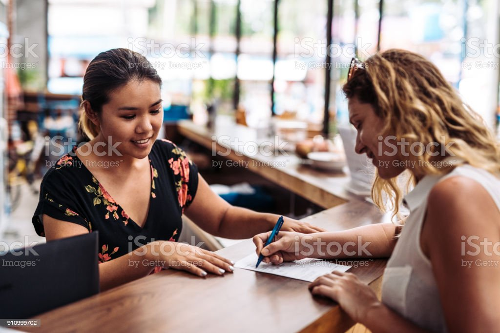 Making a reservation in the hotel stock photo