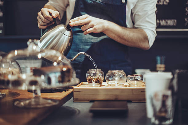 making a tea - barista making coffee stock pictures, royalty-free photos & images