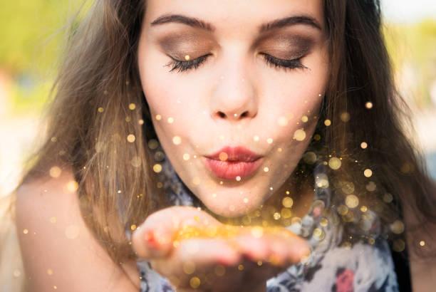making a wish - buena suerte fotografías e imágenes de stock