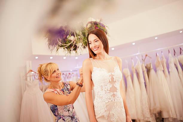 making adjustments to wedding dress - hochzeitskleid über 50 stock-fotos und bilder