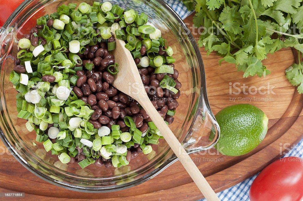 Making Black Bean Salad Top View stock photo