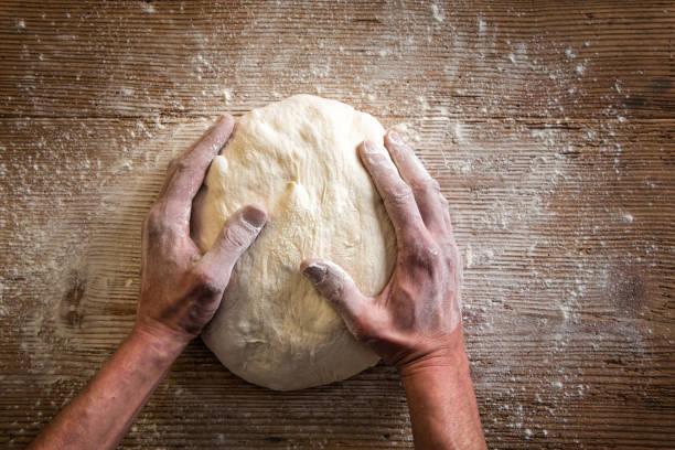 making bread dough - impastare foto e immagini stock