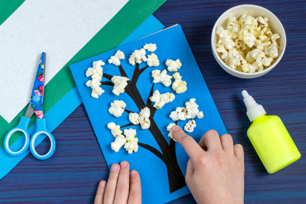 Making card by a child on spring theme. Step 5 stock photo