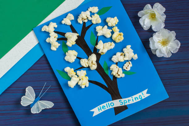 Making card by a child on spring theme. Step 8 stock photo