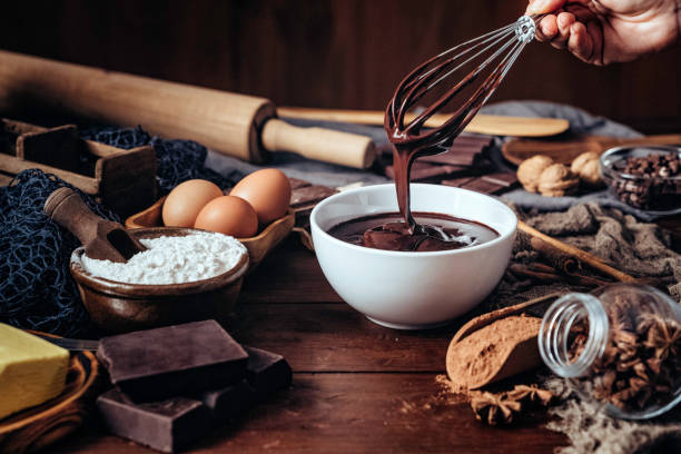 Making chocolate mousse on a wooden table in a rustic kitchen stock photo