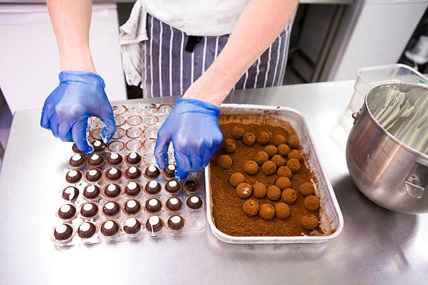 Making chocolate truffles stock photo