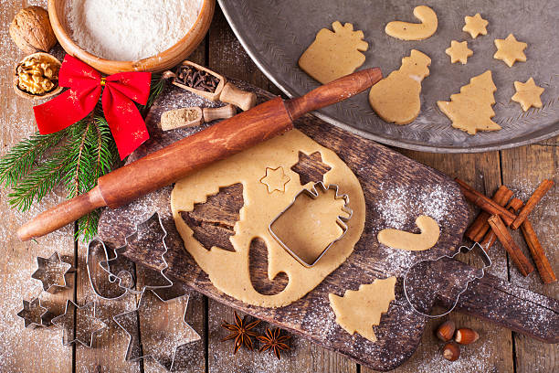 Making Christmas Cookies with traditional gingerbread cookies ingredients Making Christmas Cookies with traditional gingerbread cookies ingredients cookie cutter stock pictures, royalty-free photos & images