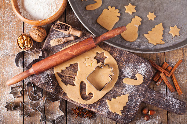 making christmas cookies with traditional gingerbread cookies ingredients - christmas cookies stock pictures, royalty-free photos & images
