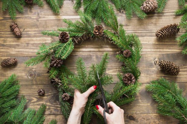 Making Christmas wreath using fresh and all natural materials. stock photo