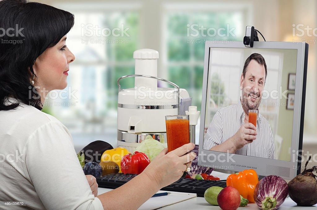 Making cleansing detox drinks online stock photo