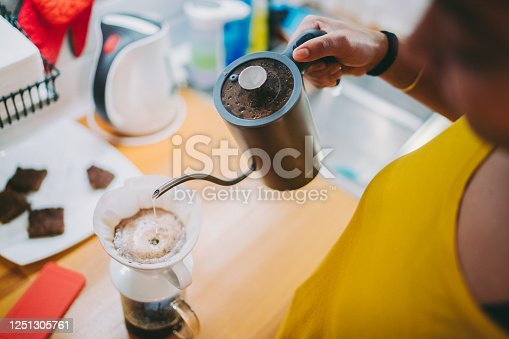 Woman preparing high quality coffee at home, covid-19 lockdown